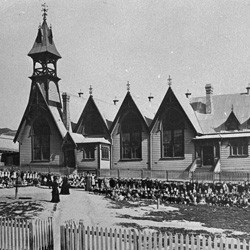 Pupils and teachers outside Mount Cook Infant School, Wellington, 1875