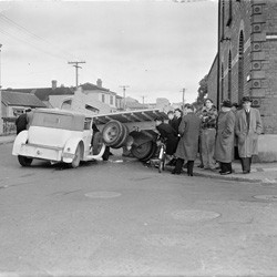 Scene of an accident between a truck and car at the corner of Tasman and Buckle Streets, Wellington, 24 July 1950.