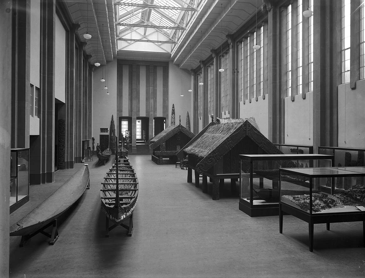 Maori artifacts, particularly waka (canoes) and pataka (storehouses), inside the Maori Hall at the Dominion Museum, Buckle Street, Wellington, c.1936