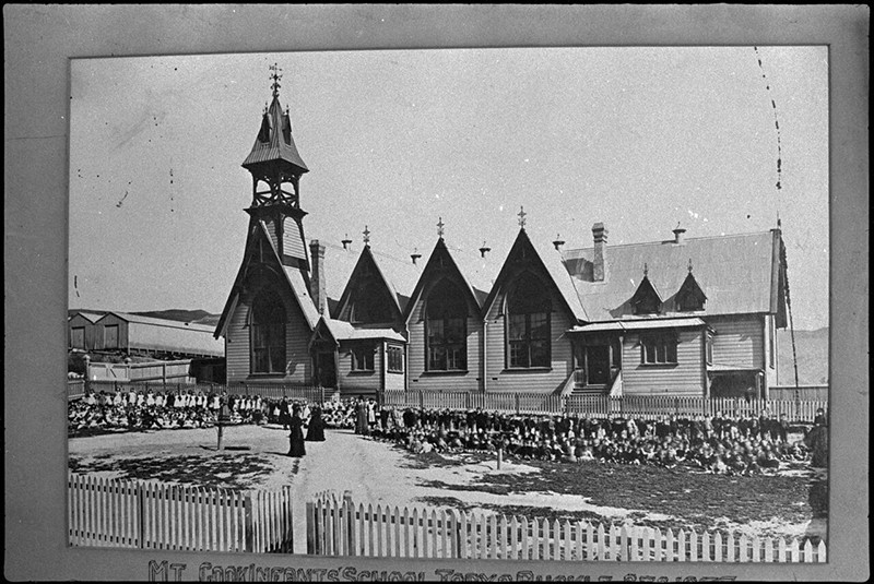 Pupils and teachers outside Mount Cook Infant School, Wellington, 1877.